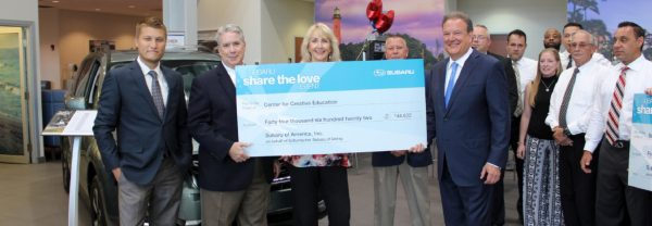 Schumacher Subaru West Palm Beach presents check to local Boys and Girls Club as part of Subaru Share the Love Fundraiser