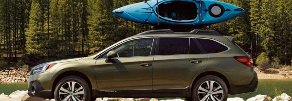 The 2018 Subaru Outback transporting a kayak, in a blog post about summer destinations in Wellington, FL.