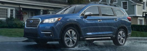 2019 Subaru Ascent driving through rainy neighborhood