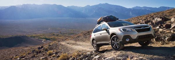 Silver 2019 Subaru Outback scaling mountain trail